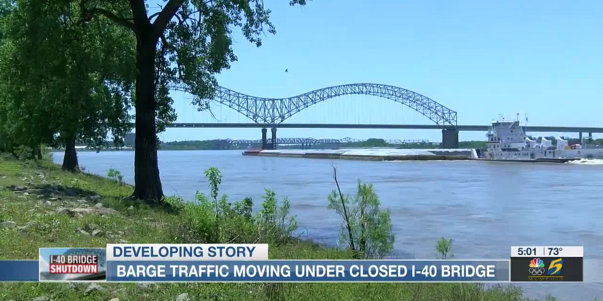 Barge traffic moving under closed I-40 bridge