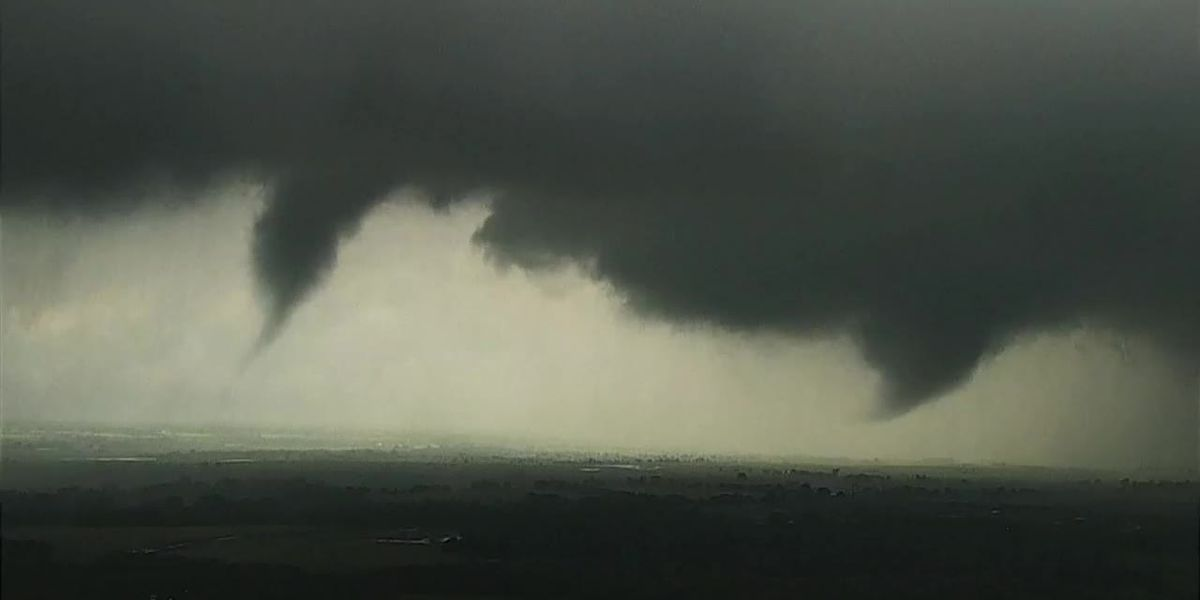 Funnel clouds form near Crescent, OKla.