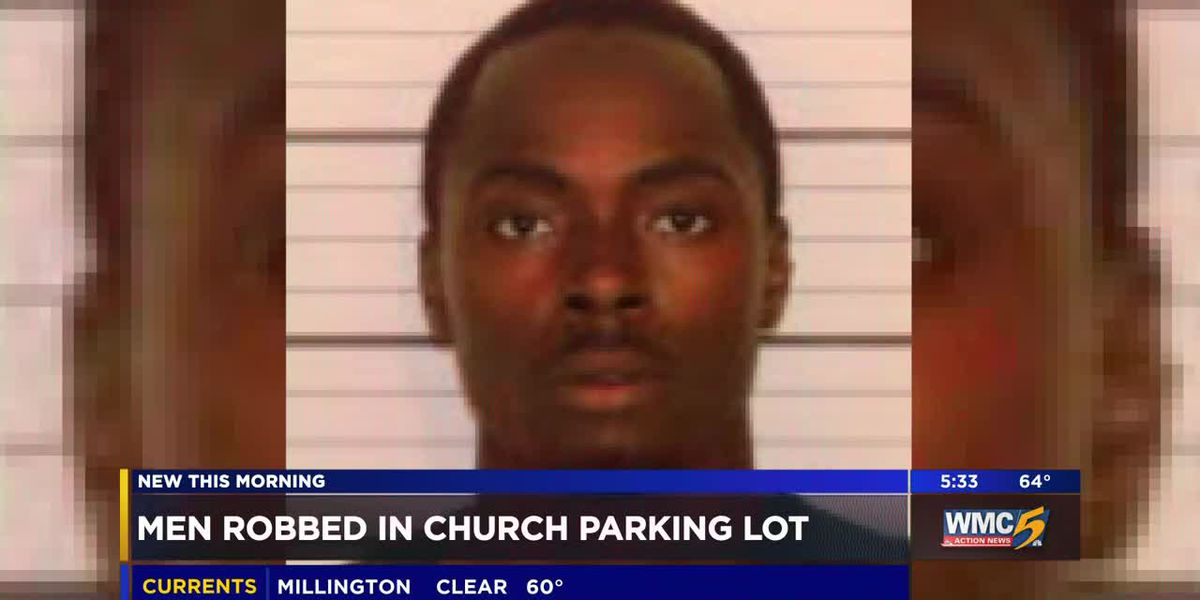 Man charged with robbing 2 men in church parking lot