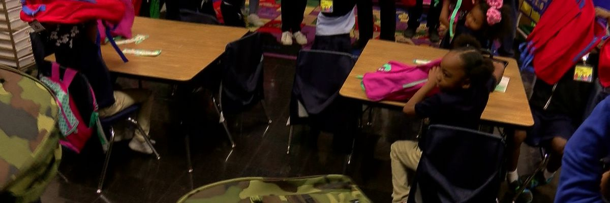 Young students surprised with free backpacks full of school supplies
