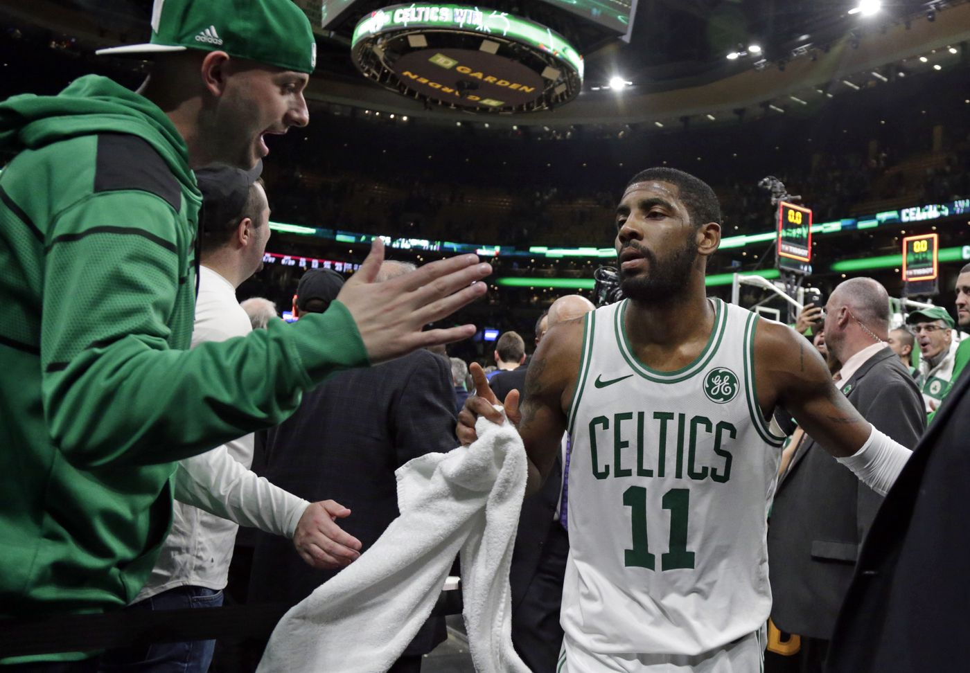 A fan reaches out to Boston Celtics guard Kyrie Irving (11) after an NBA