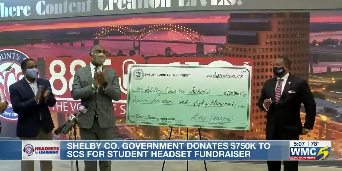 Shelby County govt. presents SCS with headset money 6p