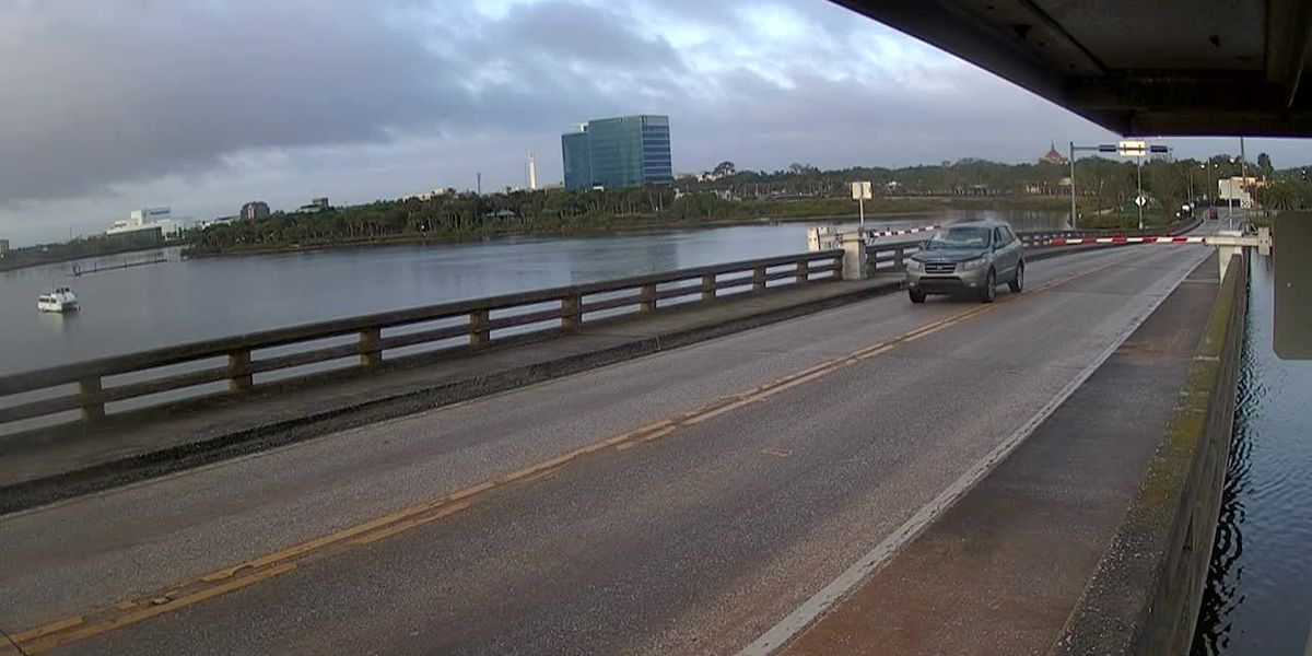 Driver goes through rising drawbridge in Daytona Beach