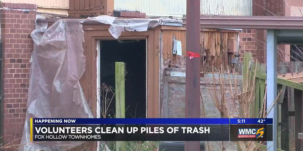 Volunteers clean up piles of trash from Fox Hollow Townhomes