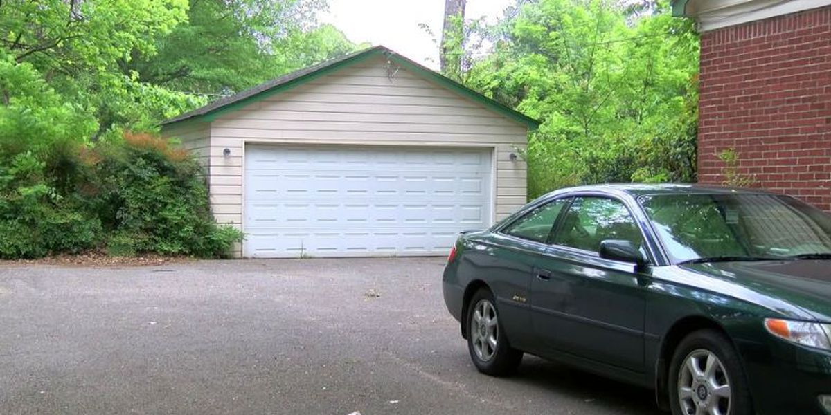 Woman robbed at gunpoint in own driveway