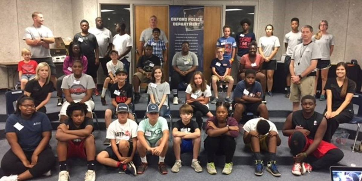 Middle school students learn what it's like being a police officer