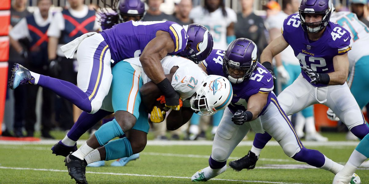 Dolphins' Gore injures left ankle against Vikings