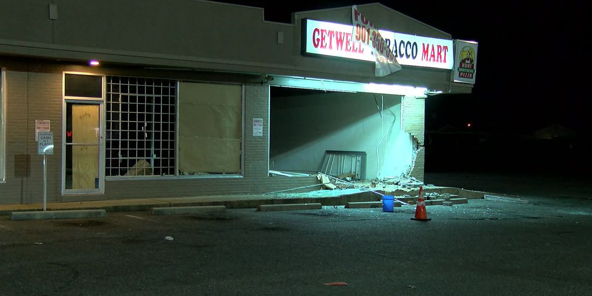 Driver flees after truck crashes into business