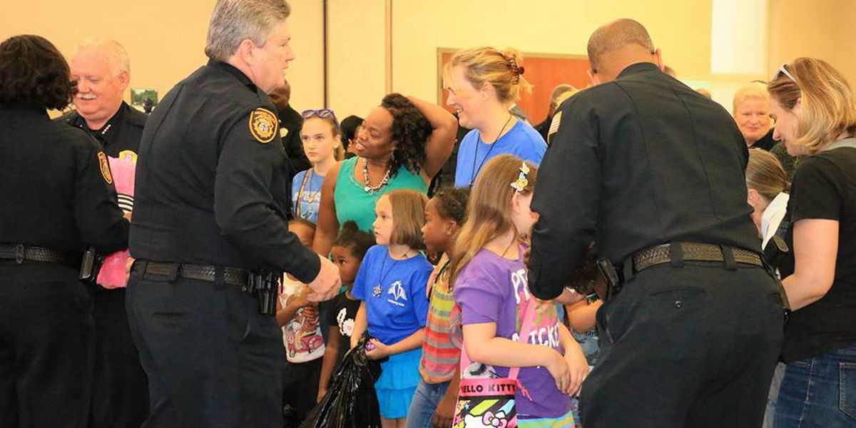 Officers hand out stuffed animals to Memphis children