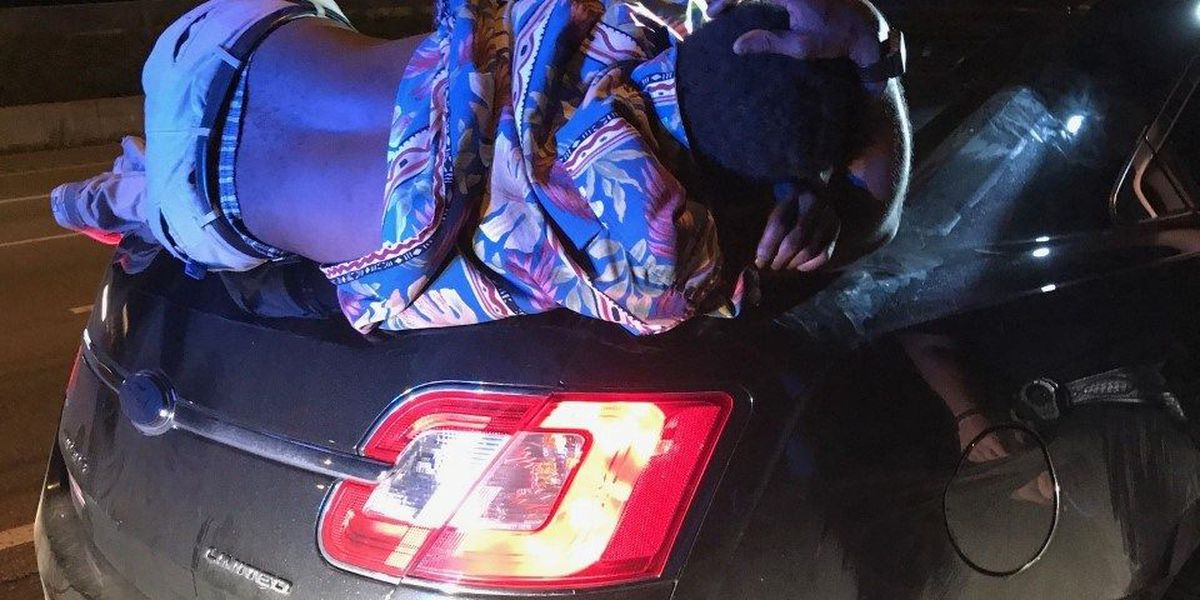 Couple drives with passed out man on car trunk for over 10 miles