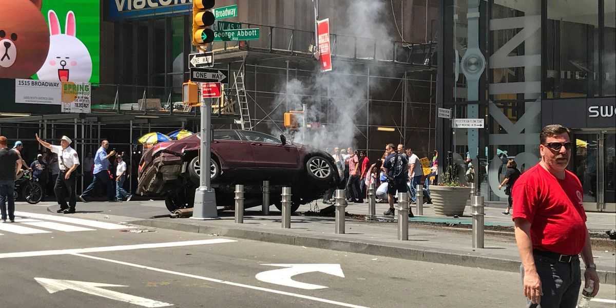 At least one dead after car slams into Times Square