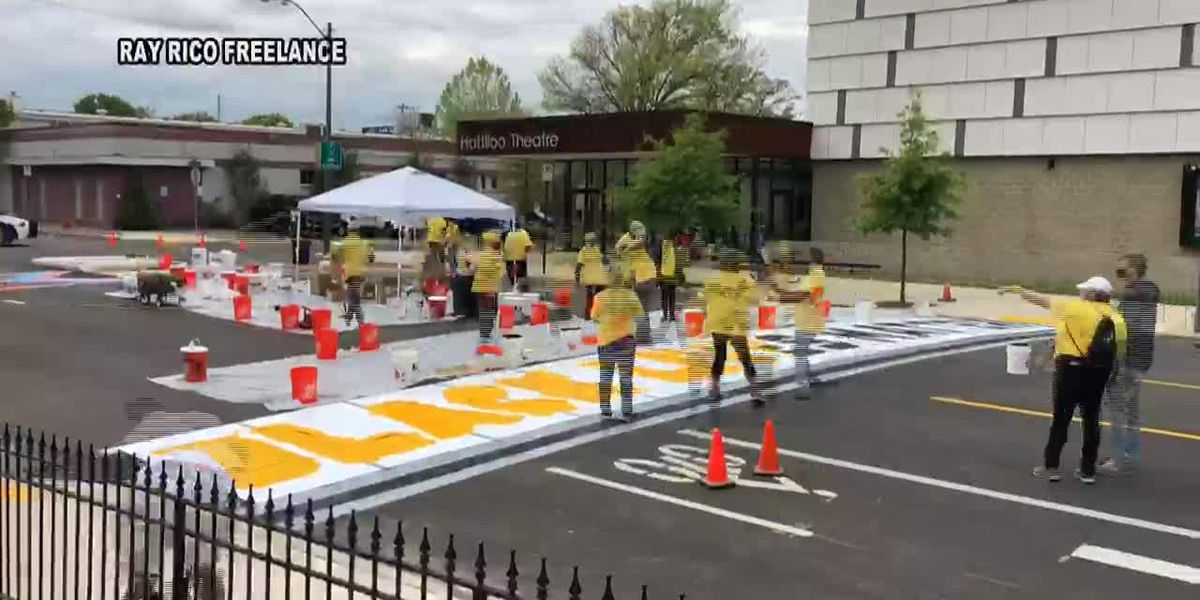 Volunteers create Black Lives Matter crosswalk in Midtown