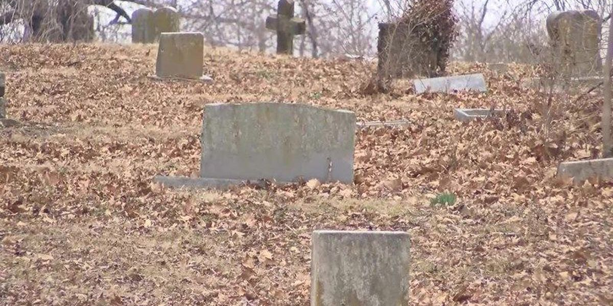 Cemetery tombstones cleared of debris