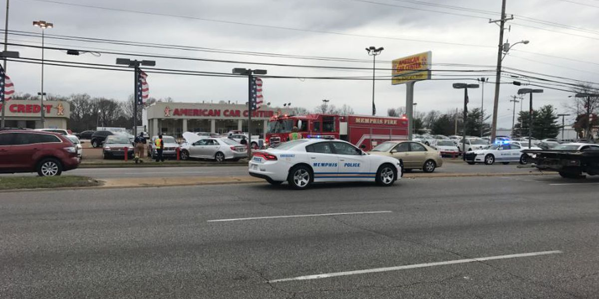 Car crashes into railing, other cars at American Car Center
