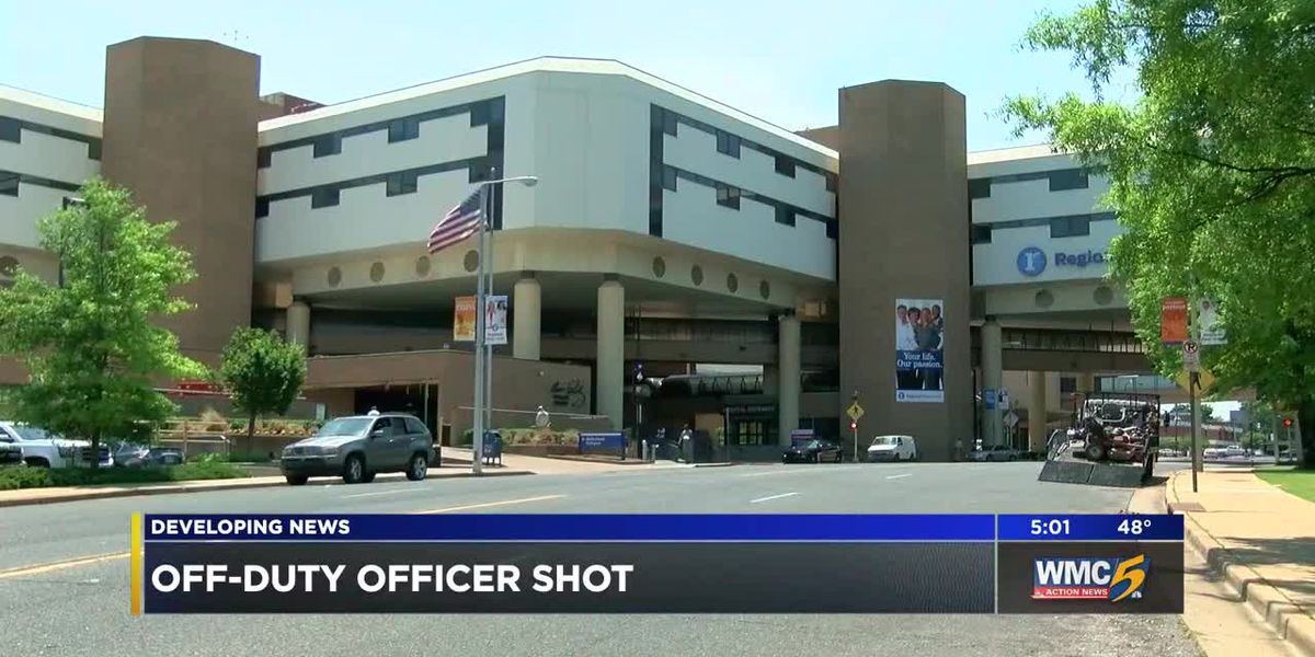 Off-duty officer shot while passing car; motive unclear