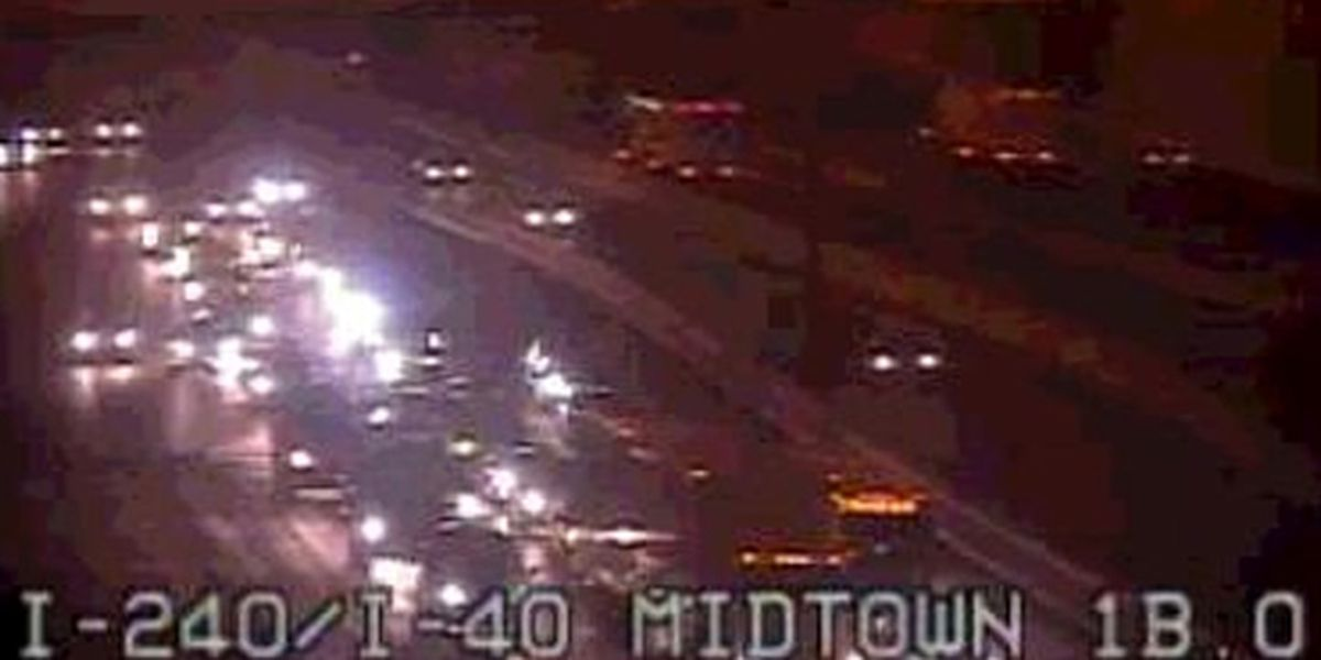 Overturned car blocks I-240 traffic