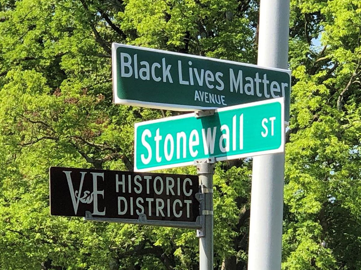 Memphis street signs covered with 'Black Lives Matter Avenue' signs