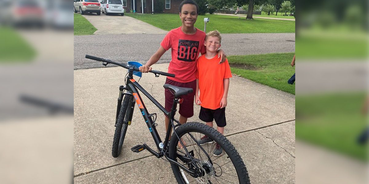 Young boy wins bike, gives neighbor the new wheels