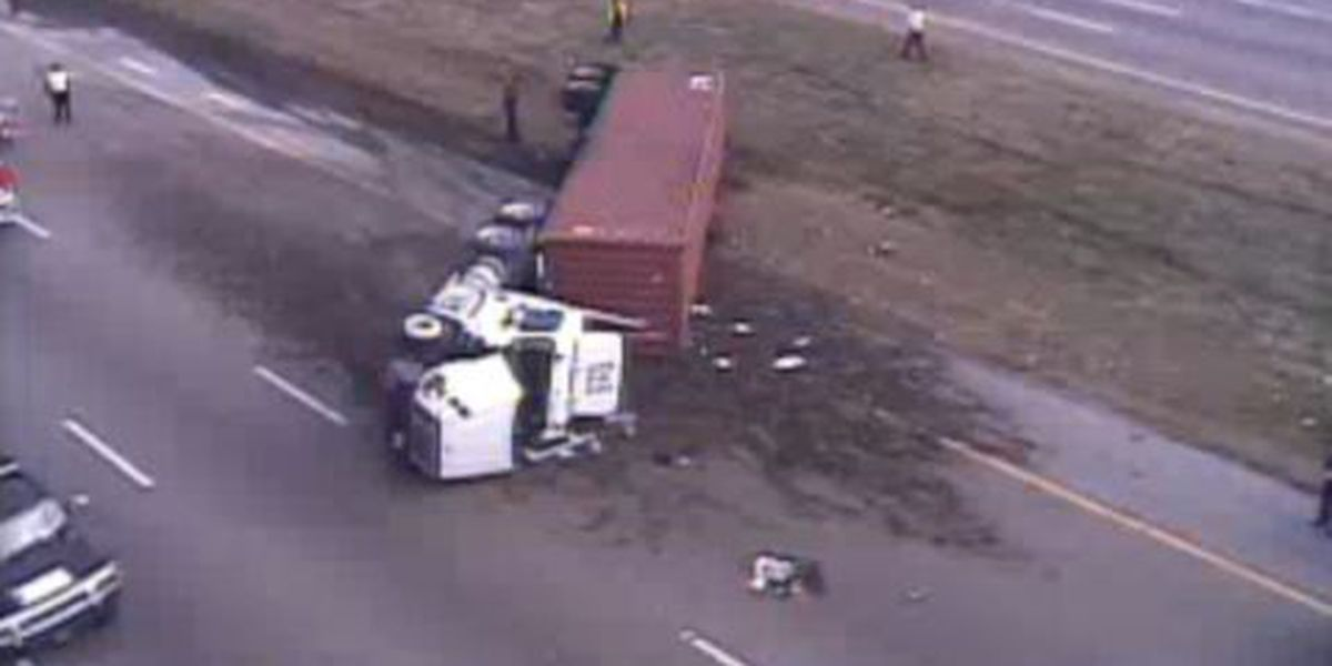 18-wheeler flips over at I-240 and Airways