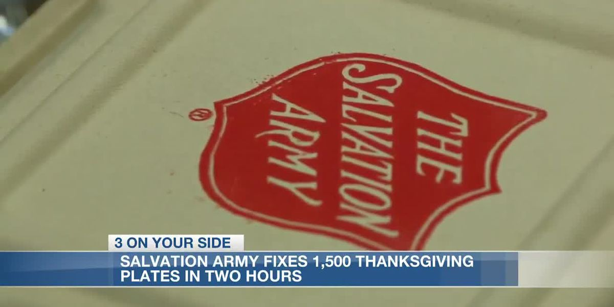 Salvation Army volunteers pack hundreds of Thanksgiving meals for those in need