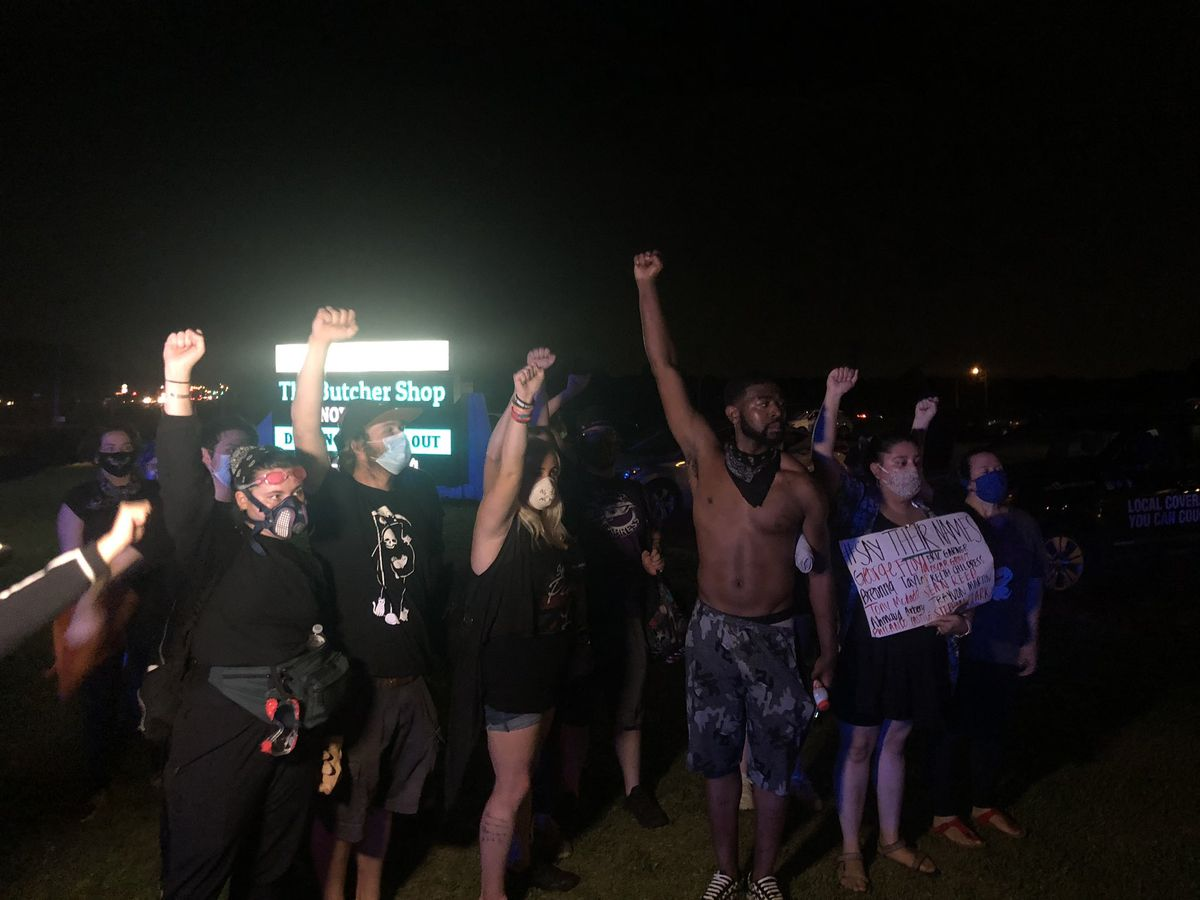 Protesters block off busy intersection of Germantown Parkway at Timber Creek