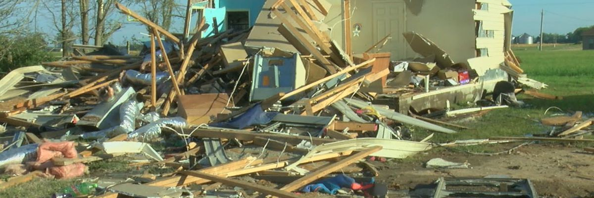 Mother and daughter cling to one another through tornado