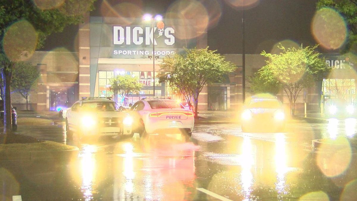 Woman grazed during shooting outside shopping center