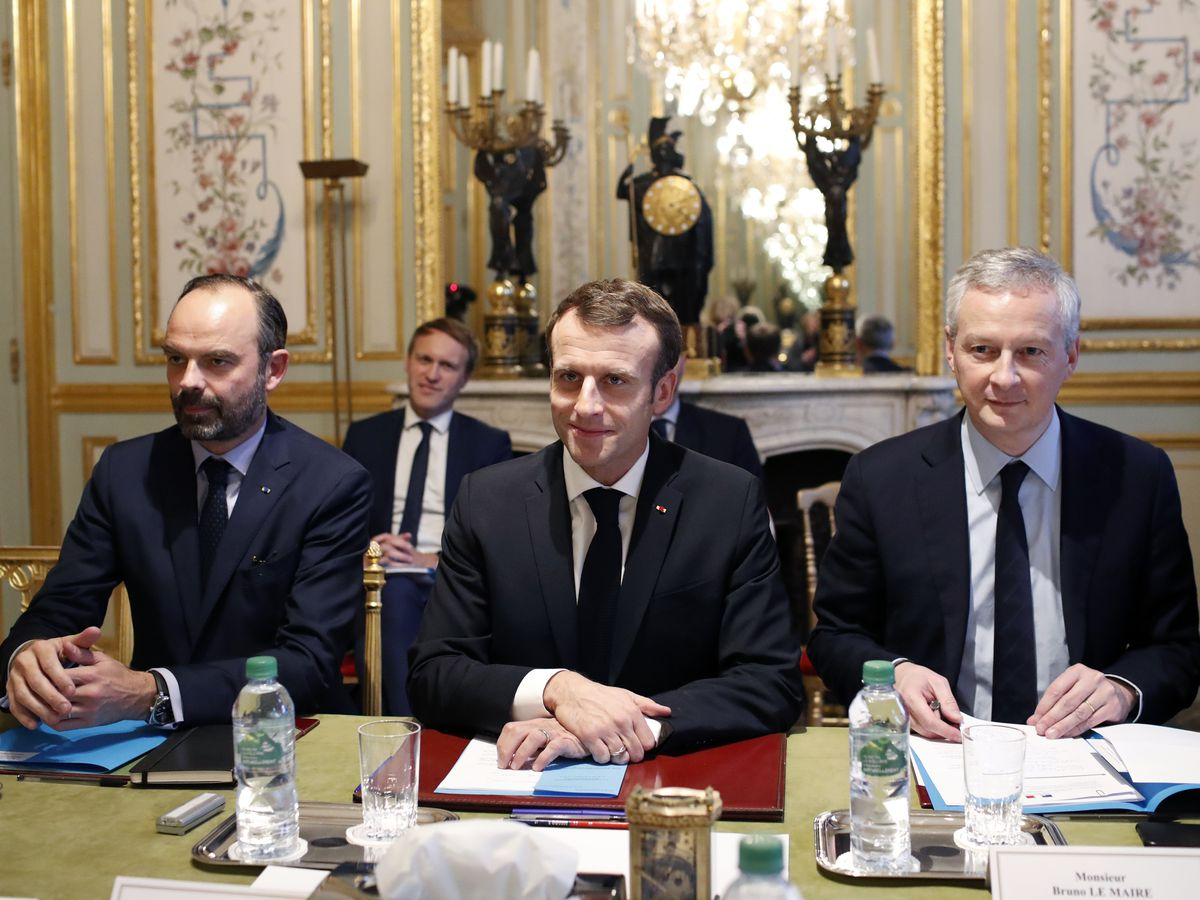 France's Macron caught between protests, Strasbourg attack