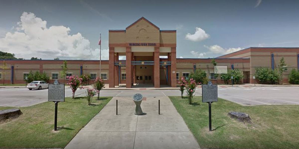 Accused gang member fights with officers inside high school