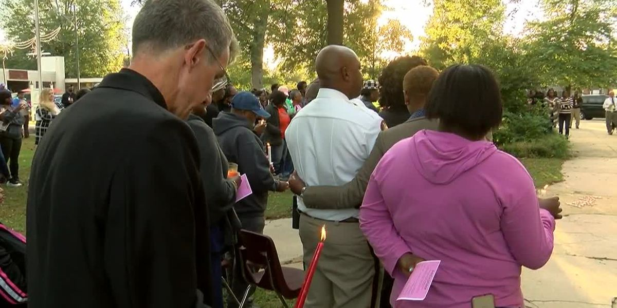 Community comes together at candlelight vigil for toddler stabbed, cooked in oven