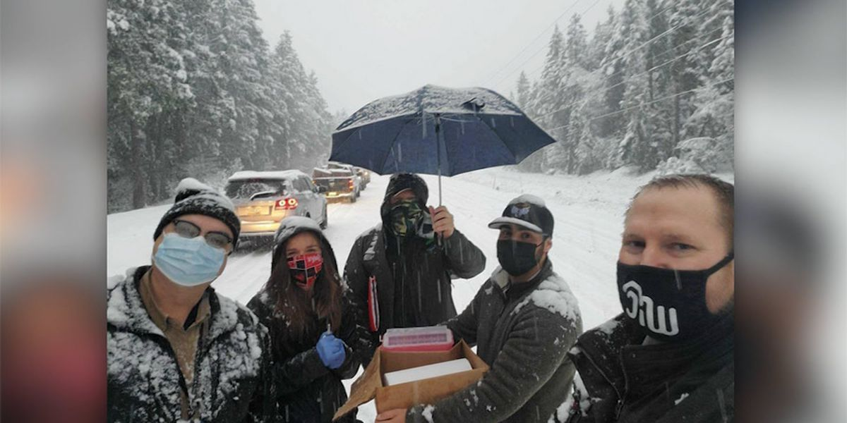 Health workers stuck in snow give other drivers vaccine