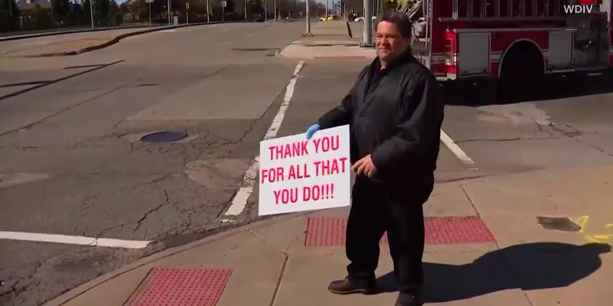 Man buys gas for nurses in Detroit; firefighters salute NY healthcare workers