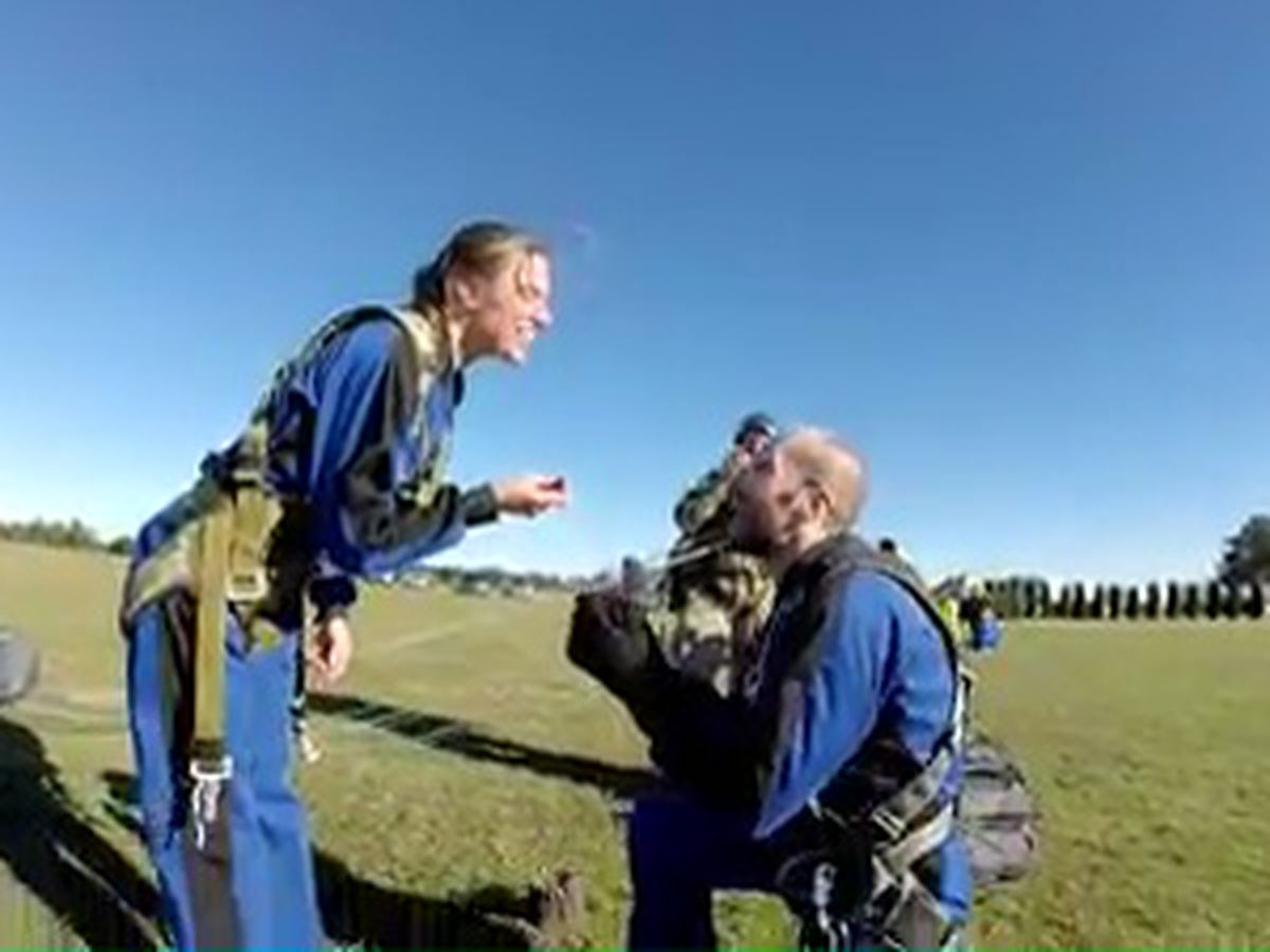 Couple surprises each other with skydive proposal