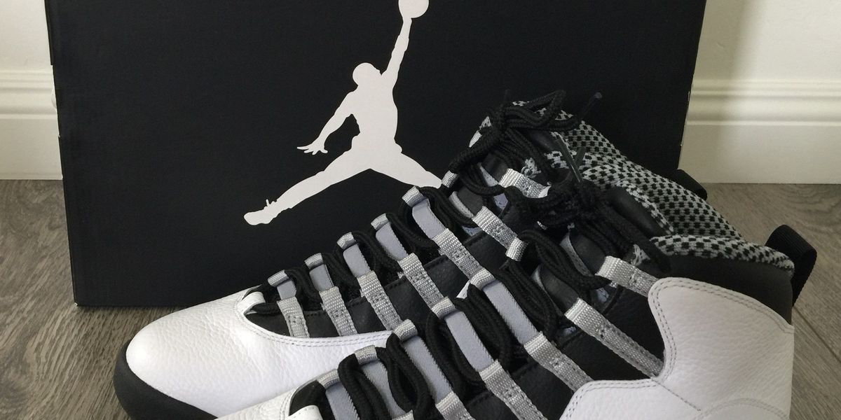 Men with an assault rifle rob people of Air Jordans