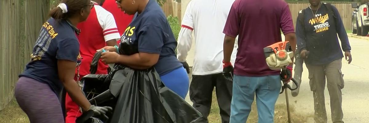 Volunteers help mow grass around Hickory Ridge Middle School