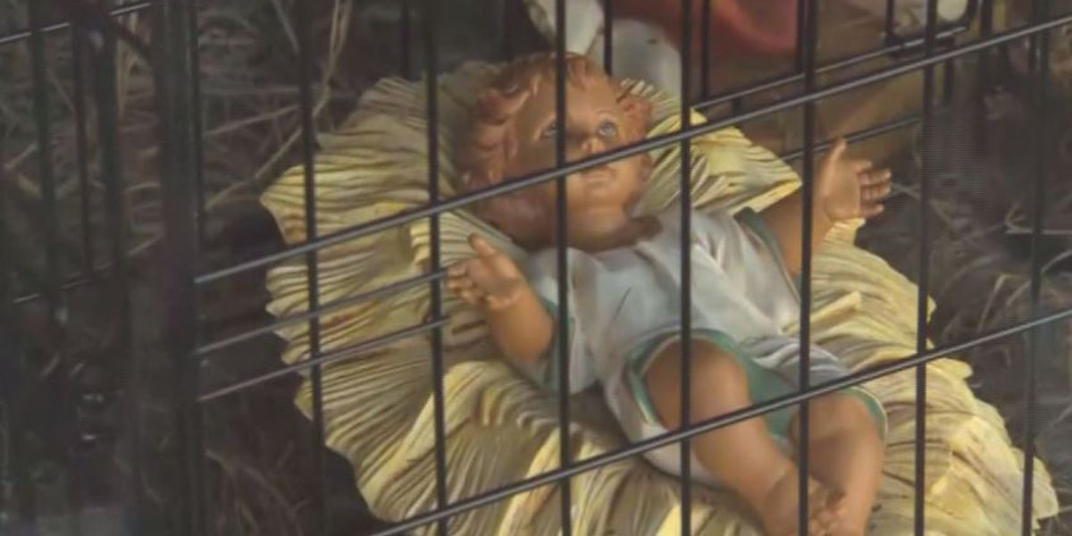 Church's nativity scene puts baby Jesus in cage, wise men behind border wall
