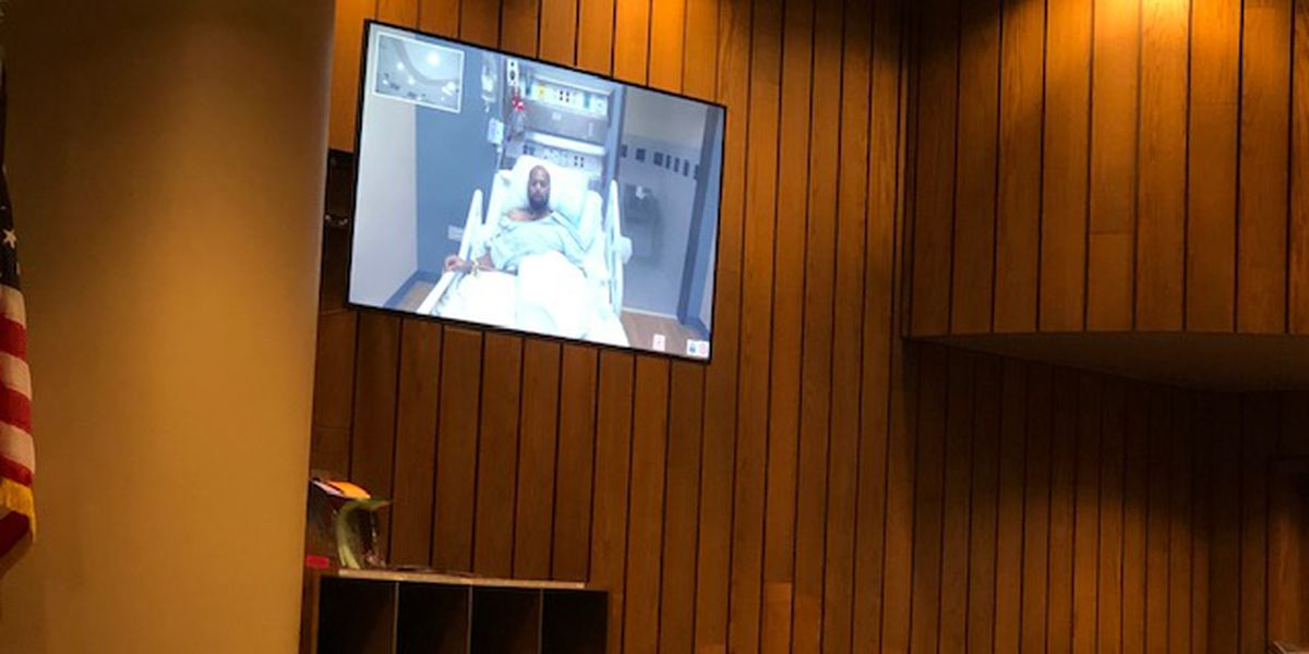 Accused Walmart killer faces judge from hospital bed