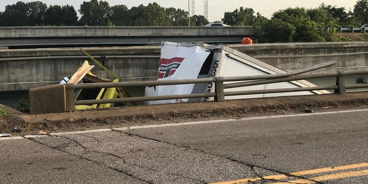 18-wheeler falls over guard rail on I-240