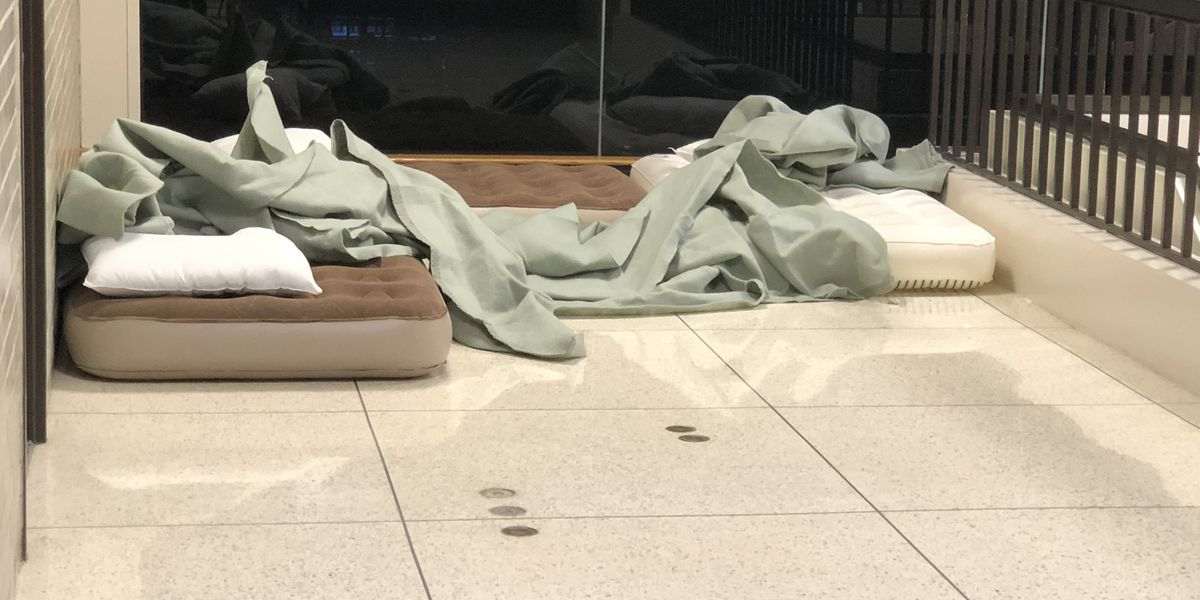 Passengers sleep on cots at Memphis airport after canceled flight