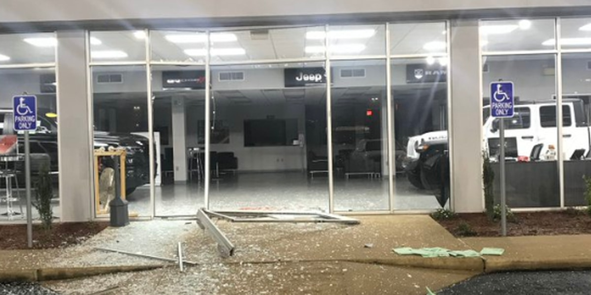 Suspect crashes through showroom doors of West Memphis car dealership