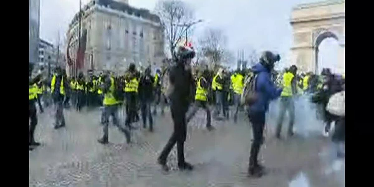 Protests against French president, fuel price hikes lock down Paris