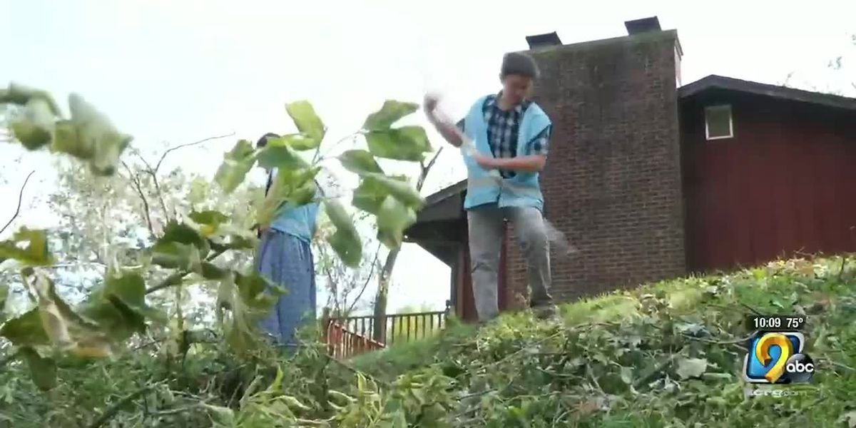 Volunteers help clean up storm damage in Iowa