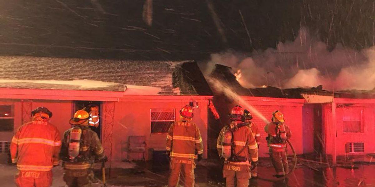 West Memphis fire crews battle motel fire amid snowfall