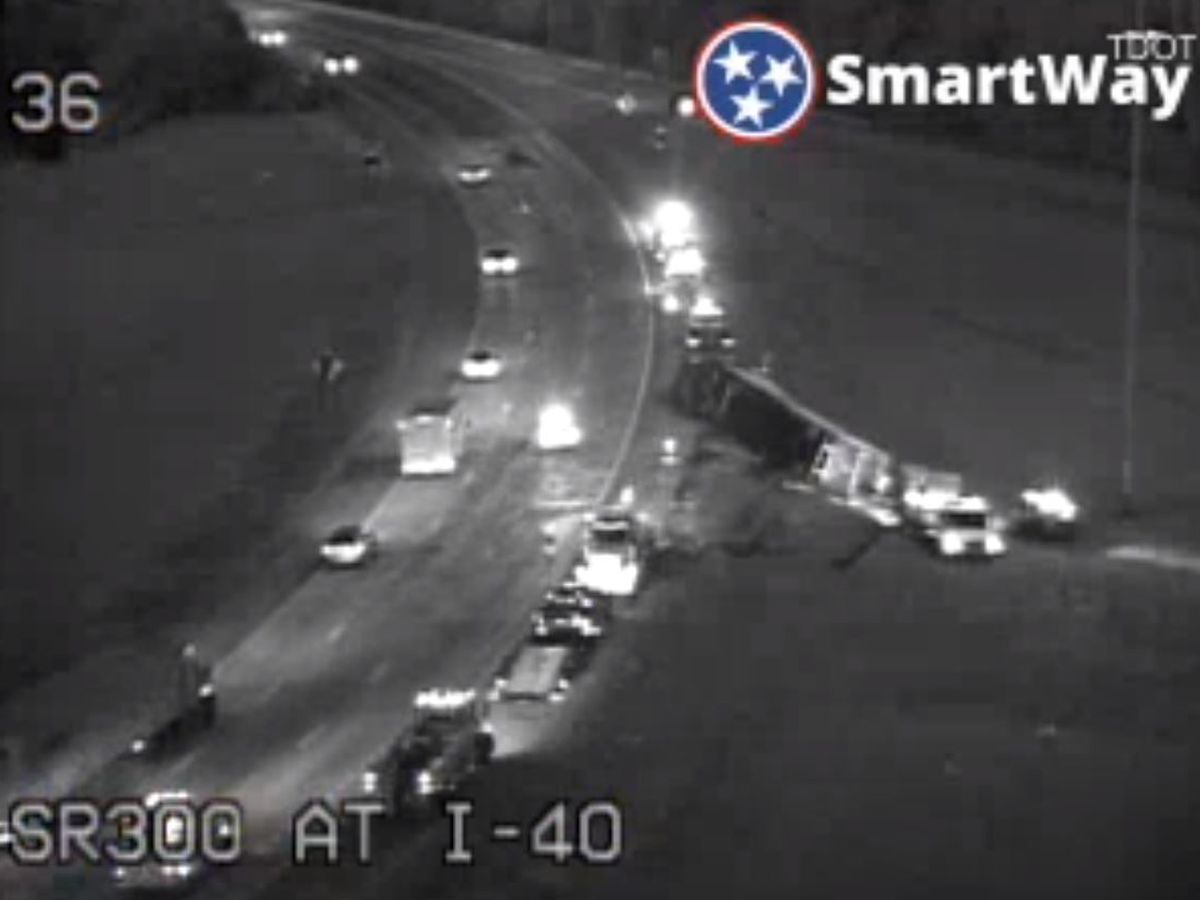 18-wheeler overturns on I-40