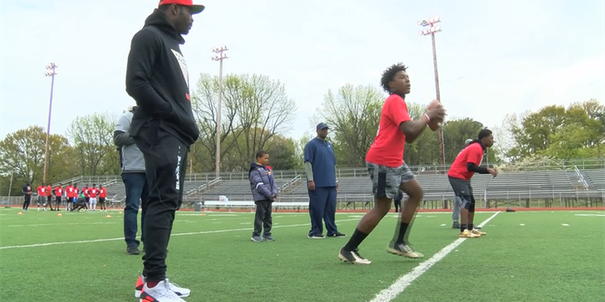 Michael Vick brings football camp to Whitehaven High