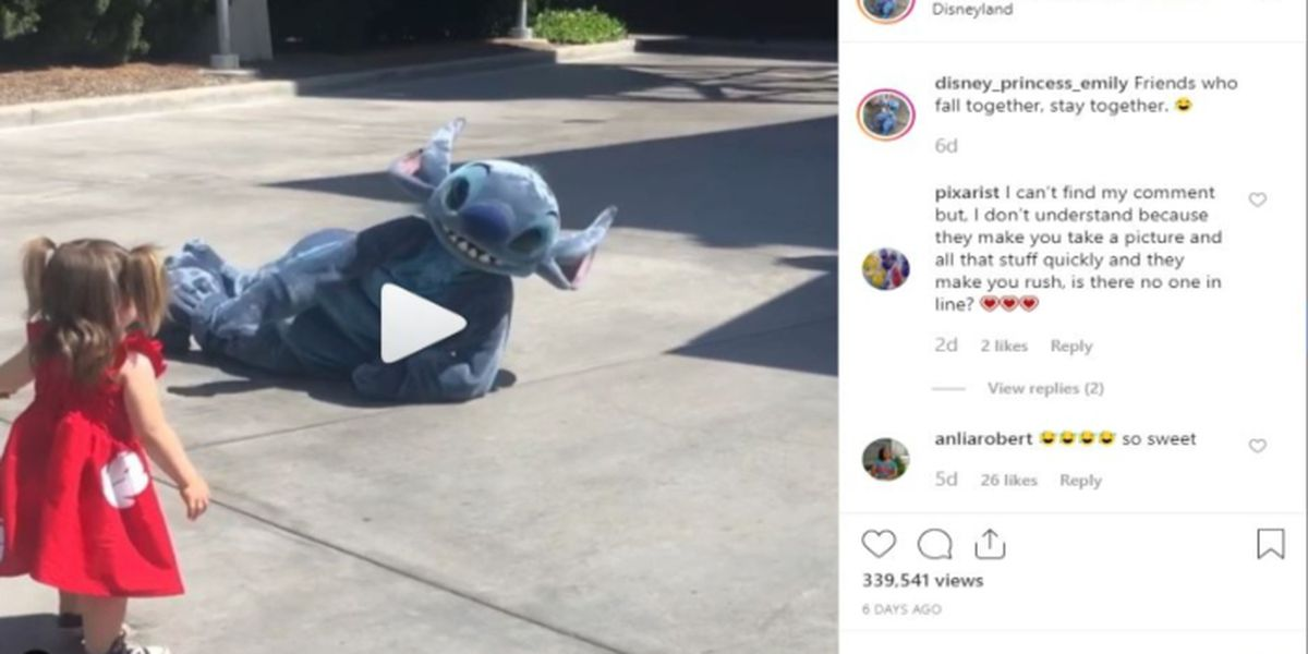 WATCH: Little girl tumbles as she runs to hug Stitch, so he falls too