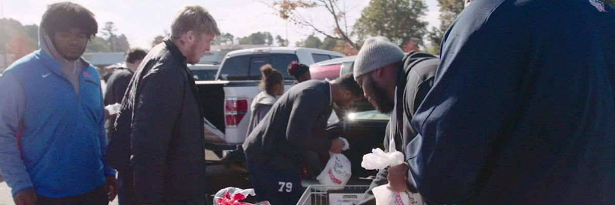 Ole Miss football team buys Thanksgiving groceries for families