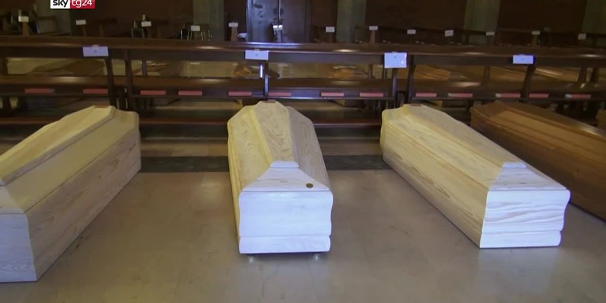A church in Italy is being used as a makeshift cemetery for up to 80 coffins